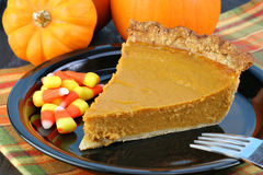 Pumpkin Pie Slice and candy corn Stock Image