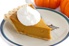 Pumpkin Pie Slice With Cream Topping Stock Image