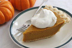 Pumpkin Pie Slice With Fork Stock Photos