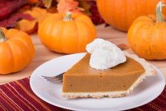 Pumpkin Pie Slice and Pumpkins Stock Photos