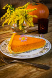 Pumpkin pie slice on the rustic wooden table Stock Photos