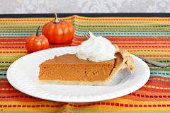 Pumpkin pie slice with whipped cream. Stock Photography
