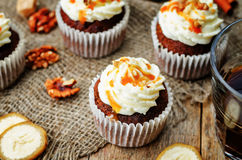 Pumpkin pie spices walnuts banana cupcakes with salted caramel a Royalty Free Stock Photo