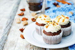 Pumpkin pie spices walnuts banana cupcakes with salted caramel a. Nd cream cheese frosting. toning. selective Focus Royalty Free Stock Photos