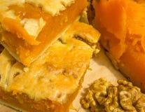 Pumpkin pie and walnut kernels Stock Photos