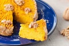 Pumpkin pie with walnuts, sliced Stock Image