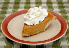 Pumpkin pie with whipped cream Royalty Free Stock Images