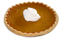 Pumpkin pie on white. Isolated image of a pumpkin pie with whipped cream on top. This image also contains a path Royalty Free Stock Image