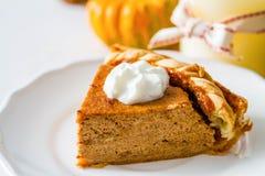 Pumpkin pie, white wood background. Pumpkin pie and decorations, white wood background, closeup Royalty Free Stock Photos