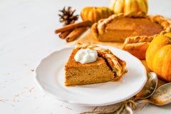 Pumpkin pie, white wood background. Pumpkin pie and decorations, white wood background, closeup Stock Image
