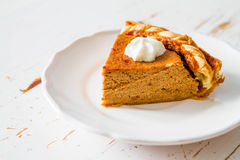 Pumpkin pie, white wood background. Pumpkin pie and decorations, white wood background, closeup Stock Photography