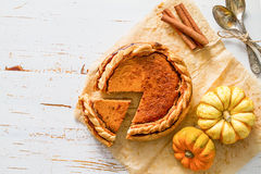 Pumpkin pie, white wood background. Top view Royalty Free Stock Photography