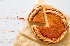 Pumpkin pie, white wood background. Top view Royalty Free Stock Image
