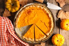 Pumpkin pie. On wood background stock photos