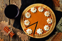 Pumpkin pie. On a wood background. toning. selective focus royalty free stock images
