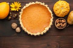 Pumpkin pie on wooden background Stock Photos