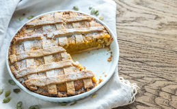 Pumpkin pie on the wooden background Royalty Free Stock Photo