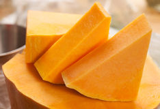 Pumpkin pieces. Triangle orange raw pumpkin pieces Royalty Free Stock Images