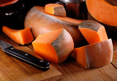 Pumpkin pieces on the table Stock Photo