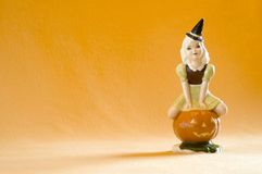 Pumpkin Pixie and Orange Background Stock Photo