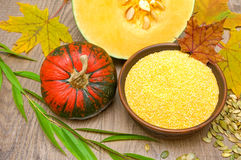 Pumpkin and polenta in a bowl on a wooden background Stock Image