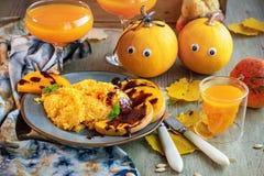 Pumpkin porridge and baked pieces of pumpkin. stock photo