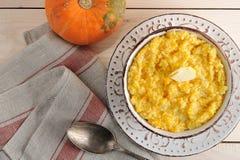 Pumpkin porridge with butter and a pumpkin Stock Image