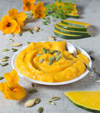 Pumpkin porridge in flax napkin Royalty Free Stock Images