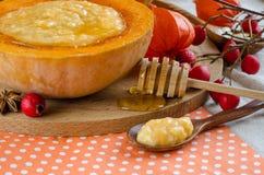Pumpkin porridge with honey Royalty Free Stock Photography