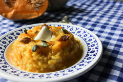 Pumpkin porridge with raisins honey nuts. blue table cloth Royalty Free Stock Images