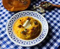 Pumpkin porridge with raisins honey nuts. Stock Photo
