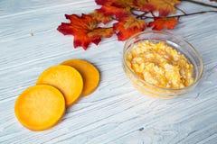 Pumpkin porridge. With rice near the pumpkin's slices Stock Images