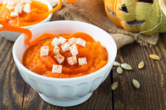 Pumpkin porridge topped with feta cheese  on a background of fun Stock Images