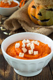 Pumpkin porridge topped with feta cheese  on a background of fun Royalty Free Stock Image