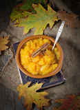 Pumpkin porridge in wooden background Royalty Free Stock Photography