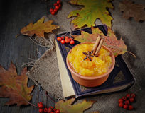 Pumpkin porridge in wooden background Royalty Free Stock Photos