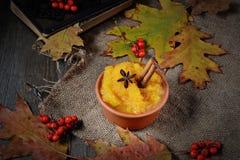 Pumpkin porridge in wooden background Royalty Free Stock Photography