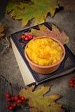 Pumpkin porridge in wooden background Royalty Free Stock Photo