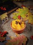 Pumpkin porridge in wooden background Stock Photo