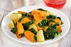 Pumpkin and potato with spinach Stock Photography