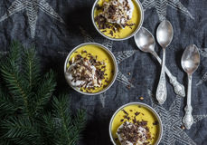Pumpkin pudding with whipped cream, chocolate and christmas tree. On a dark background Royalty Free Stock Images