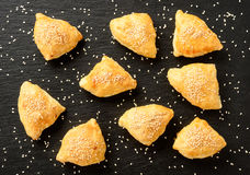 Pumpkin puffs triangles on black background. Royalty Free Stock Photo