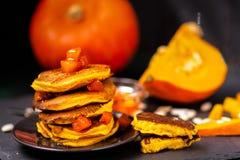 Pumpkin and pumpkin dishes.Jam and pumpkin pancakes. royalty free stock images