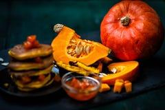Pumpkin and pumpkin dishes.Jam and pumpkin pancakes. royalty free stock photos