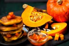 Pumpkin and pumpkin dishes.Jam and pumpkin pancakes. stock images