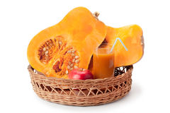 Pumpkin, pumpkin juice and apple arranged in a basket Stock Photography