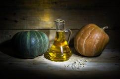 Pumpkin and pumpkin seed oil. Still life with pumpkin, pumpkin oil and pumpkin seeds Stock Images