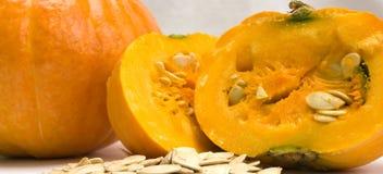 A pumpkin and pumpkin seeds stock photography