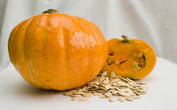 A pumpkin and pumpkin seeds. The image of A pumpkin and pumpkin seeds Royalty Free Stock Photos