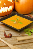 Pumpkin puree on a black plate Royalty Free Stock Photos